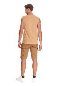 TOP SECRET - Gładki t-shirt bez rękawów. Kolor: beżowy. Materiał: bawełna, tkanina, jeans. Długość rękawa: bez rękawów. Długość: długie. Wzór: gładki. Sezon: lato. Styl: sportowy