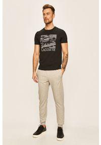 Szare spodnie dresowe Guess Jeans