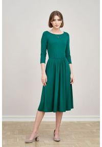 Marie Zélie - Sukienka Emelina ciemnozielona. Kolor: zielony. Materiał: wiskoza, dzianina, materiał, elastan, tkanina, guma. Styl: klasyczny. Długość: midi