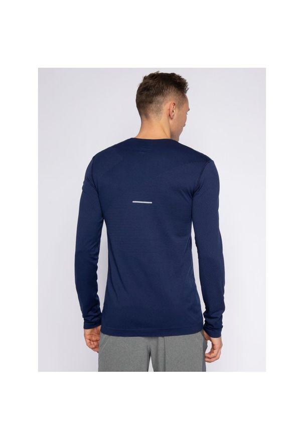 Niebieska koszulka sportowa Asics