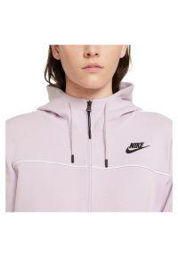 Bluza damska Nike Sportswear Millenium Fleece CZ8338. Typ kołnierza: kaptur. Materiał: materiał, bawełna, poliester. Wzór: gładki, ze splotem