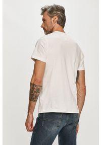 Tommy Jeans - T-shirt. Okazja: na co dzień. Kolor: biały. Materiał: dzianina. Wzór: nadruk. Styl: casual