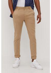 Levi's® - Levi's - Spodnie. Okazja: na spotkanie biznesowe. Kolor: beżowy. Materiał: tkanina, bawełna. Wzór: gładki. Styl: biznesowy