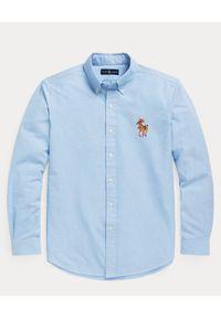 Ralph Lauren - RALPH LAUREN - Niebieska koszula z misiem Polo. Typ kołnierza: polo. Kolor: niebieski. Materiał: bawełna. Długość rękawa: długi rękaw. Długość: długie. Wzór: haft, kolorowy. Styl: klasyczny