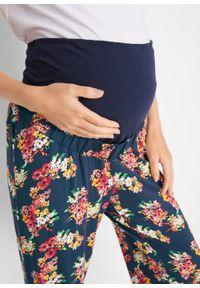 Niebieskie jeansy bonprix w kwiaty, moda ciążowa