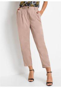 Spodnie bonprix khaki. Kolor: beżowy