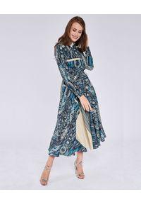THECADESS - Sukienka maxi z dodatkiem jedwabiu Sorento. Kolor: niebieski. Materiał: jedwab. Długość rękawa: długi rękaw. Typ sukienki: koszulowe. Styl: elegancki. Długość: maxi