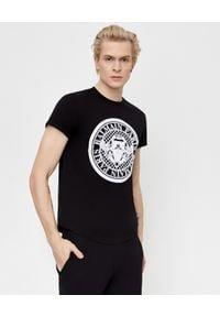 Balmain - BALMAIN - Czarny t-shirt z bawełny. Kolor: czarny. Materiał: bawełna. Styl: sportowy