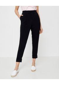 Kenzo - KENZO - Czarne spodnie. Kolor: czarny. Materiał: materiał. Styl: sportowy