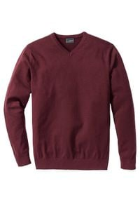Sweter z dekoltem w serek bonprix czerwony klonowy. Typ kołnierza: dekolt w serek. Kolor: czerwony. Materiał: dzianina. Wzór: ze splotem, gładki. Styl: klasyczny