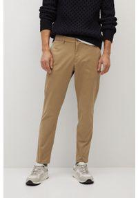 Mango Man - Spodnie PRATO. Kolor: beżowy. Materiał: tkanina. Wzór: gładki