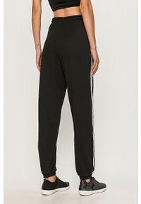 adidas Originals - Spodnie. Kolor: czarny
