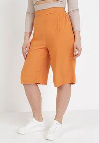 Pomarańczowe spodnie z wysokim stanem Born2be