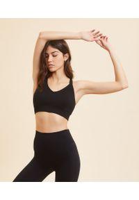 Czarny biustonosz sportowy Etam z wyjmowanymi miseczkami, na jogę i pilates