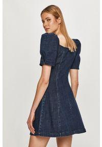 Miss Sixty - Sukienka jeansowa. Kolor: niebieski. Materiał: jeans. Długość rękawa: krótki rękaw. Typ sukienki: rozkloszowane