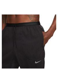 Spodnie męskie do biegania Nike Phenom Elite Run Division DA1290. Materiał: nylon, materiał, poliester. Technologia: Dri-Fit (Nike). Sport: bieganie