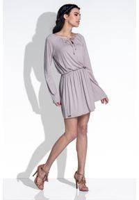 e-margeritka - Luźna sukienka z szerokimi rękawami casual - Mocca, s. Okazja: na co dzień. Kolor: czarny. Materiał: elastan, wiskoza, materiał. Sezon: wiosna, lato. Typ sukienki: proste. Styl: casual. Długość: mini
