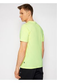 Puma T-Shirt Core International 587768 Żółty Regular Fit. Kolor: żółty