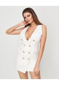 Balmain - BALMAIN - Dwurzędowa sukienka z guzikami. Kolor: biały. Materiał: wełna. Długość: mini