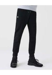 Lacoste - LACOSTE - Czarne spodnie dresowe Sport Tennis. Kolor: czarny. Materiał: dresówka. Wzór: haft, jednolity