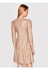 Beżowa sukienka Rinascimento