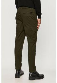 Oliwkowe spodnie Armani Exchange