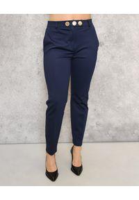 CRISTINAEFFE - Granatowe klasyczne spodnie. Okazja: na co dzień. Kolor: niebieski. Materiał: materiał. Wzór: aplikacja. Styl: klasyczny