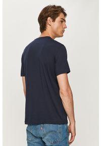Niebieski t-shirt EA7 Emporio Armani na co dzień, z nadrukiem, casualowy, z okrągłym kołnierzem