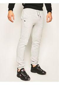 Lacoste Spodnie dresowe XH7611 Szary Regular Fit. Kolor: szary. Materiał: dresówka