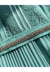 SELF PORTRAIT - Turkusowa sukienka mini z kronką. Kolor: zielony. Materiał: koronka. Wzór: koronka, aplikacja, kwiaty. Typ sukienki: dopasowane, rozkloszowane, plisowane. Długość: mini