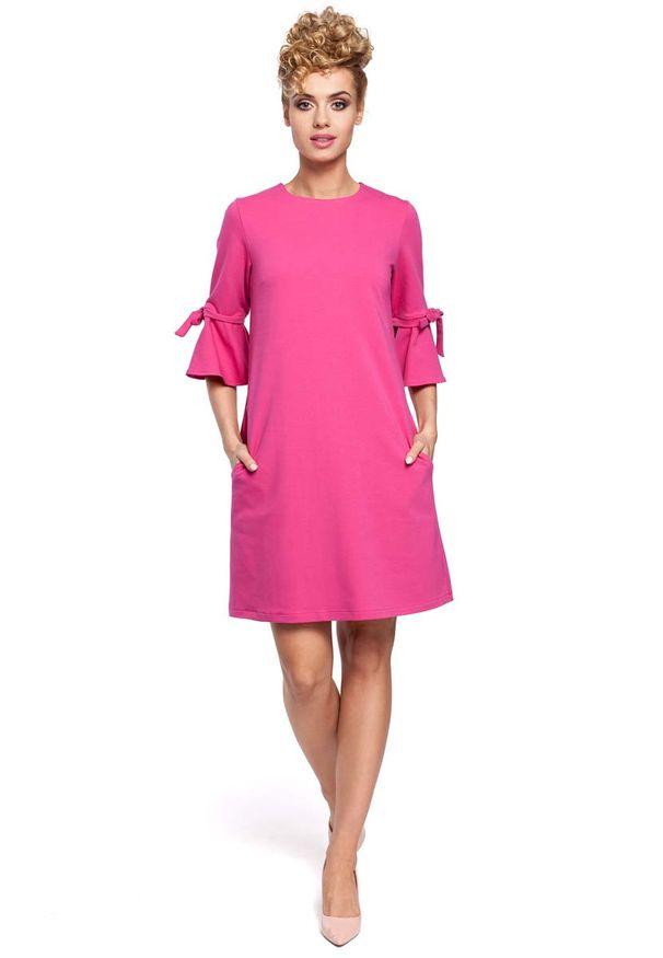 Różowa sukienka dzianinowa MOE trapezowa