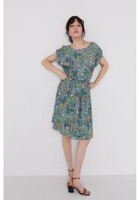 medicine - Medicine - Sukienka Commercial. Kolor: turkusowy. Materiał: tkanina. Długość rękawa: krótki rękaw. Typ sukienki: rozkloszowane