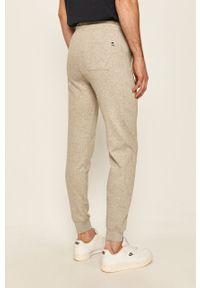 Szare spodnie dresowe Russell Athletic z aplikacjami