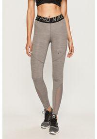 Nike - Spodnie AO9968. Kolor: szary. Materiał: tkanina, dzianina, skóra, włókno. Technologia: Dri-Fit (Nike)