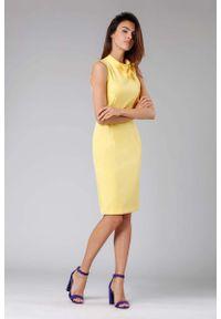Żółta sukienka wizytowa Nommo ołówkowa, z kokardą