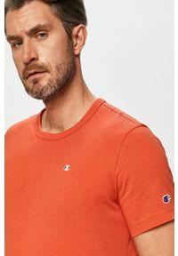 Champion - T-shirt. Okazja: na co dzień. Kolor: pomarańczowy. Materiał: dzianina. Wzór: aplikacja. Styl: casual
