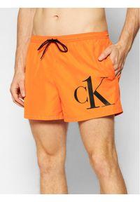 Calvin Klein Swimwear Szorty kąpielowe Drawstring KM0KM00591 Pomarańczowy Regular Fit. Kolor: pomarańczowy
