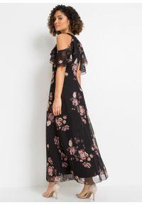 Długa sukienka z siatkowego materiału z nadrukiem bonprix czarny w kwiaty. Kolor: czarny. Materiał: materiał. Wzór: kwiaty, nadruk. Długość: maxi