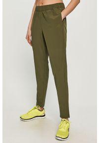 Oliwkowe spodnie dresowe adidas Performance gładkie