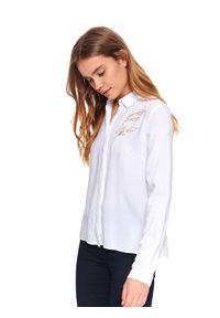 TOP SECRET - Damska koszula z aplikacją. Okazja: na co dzień. Kolor: biały. Materiał: materiał. Długość rękawa: długi rękaw. Długość: długie. Wzór: aplikacja. Sezon: wiosna. Styl: klasyczny, casual