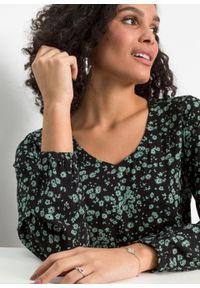Sukienka z falbanami bonprix czarno-pastelowy zielony w kwiaty. Kolor: czarny. Wzór: kwiaty