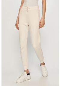 Białe spodnie dresowe Guess gładkie