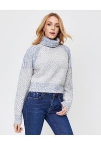 Kenzo - KENZO - Wełniany sweter z golfem. Typ kołnierza: golf. Kolor: biały. Materiał: wełna. Długość rękawa: długi rękaw. Długość: długie. Wzór: haft, ze splotem