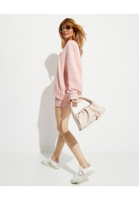NANUSHKA - Różowa bluza z logo Remy. Kolor: różowy, wielokolorowy, fioletowy. Materiał: bawełna, dresówka, jeans. Długość rękawa: długi rękaw. Długość: długie. Styl: klasyczny
