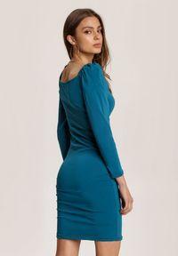 Renee - Niebieska Sukienka Jilyss. Kolor: niebieski