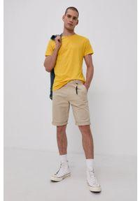 Tommy Jeans - T-shirt. Kolor: żółty. Materiał: dzianina. Wzór: aplikacja