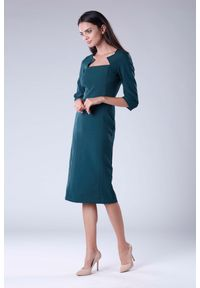 Zielona sukienka na imprezę Nommo elegancka