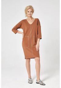 e-margeritka - Sukienka dresowa trapezowa cynamonowa - xl. Okazja: na co dzień. Kolor: brązowy. Materiał: dresówka. Typ sukienki: trapezowe. Styl: casual
