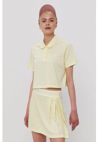 adidas Originals - T-shirt. Kolor: żółty. Materiał: dzianina, poliester. Długość: krótkie. Wzór: gładki