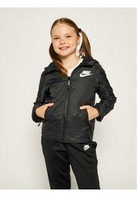 Nike Kurtka przejściowa Jeune 939556 Czarny Standard Fit. Kolor: czarny